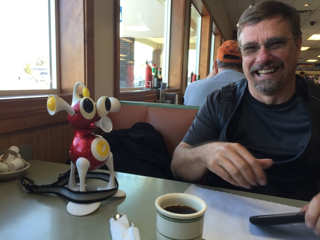 Stopping for breakfast at the Indy Diner in Longview Wash. Flip has his leash around his ankles, but is already enjoying the trip. Montana or bust!