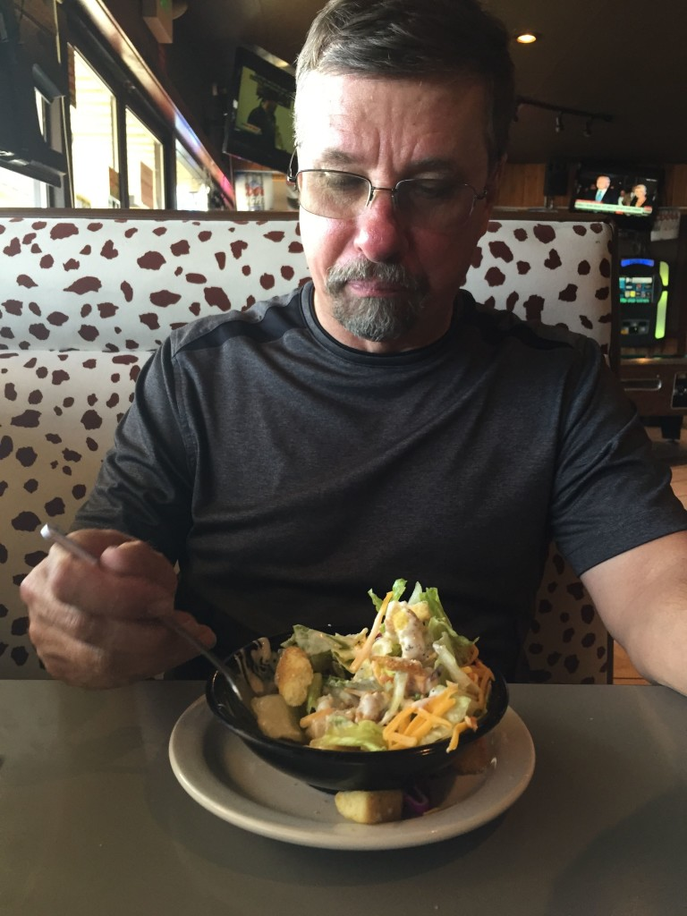 Carl's salad got hit by a tsunami when he put his fork in.