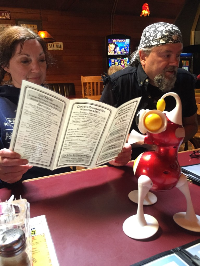 At our soon-to-be favorite restaurant in Depoe Bay, Gracie's Sea Hag, head hag and her hagger peruse the options while we wait on our condo to be ready.